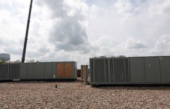 Industrial HVAC systems on rooftop. Equipment retrofits.