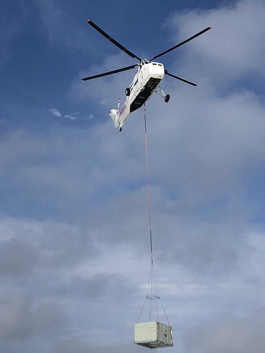 JS Thomas Mechanical air crane transporting HVAC unit.